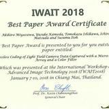 本学教員と大学院生らがIWAIT2018においてBest Paper Awardを受賞